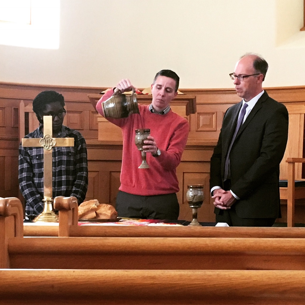 Jess Cook celebrates Communion with Rev. Annanda Barclay (left) and Rev. Scott Clark (right)